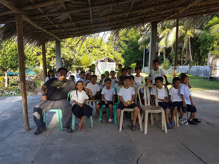 Sales Rain Admin & Facilities Manager, Mr. Billy Espina with the school children